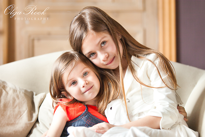 Natural light portrait of two little girls in a living room.