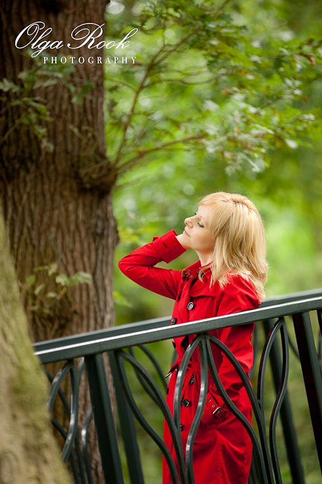 Another photo of a girl in red on a bridge.