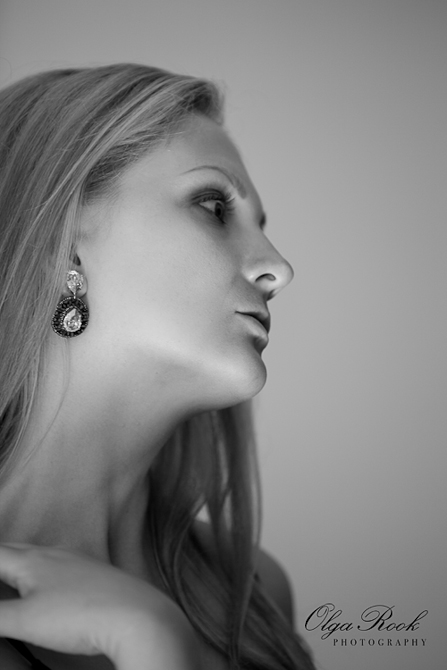 Antique looking black and white portrait of a beautiful girl seen in profile.