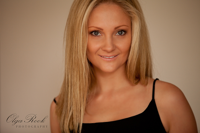 Fashion portrait of a girl with long blond hair and dark eyes.