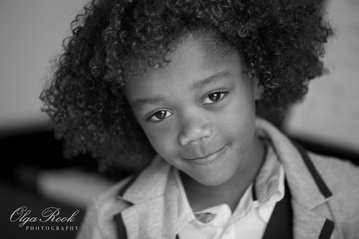 Timeless black and white portrait of a little curly boy.