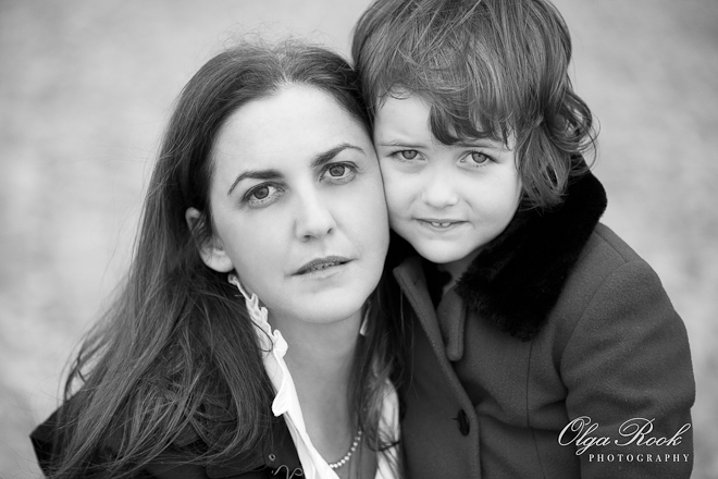 Classic black and white portrait of a beautiful woman and her little daughter.