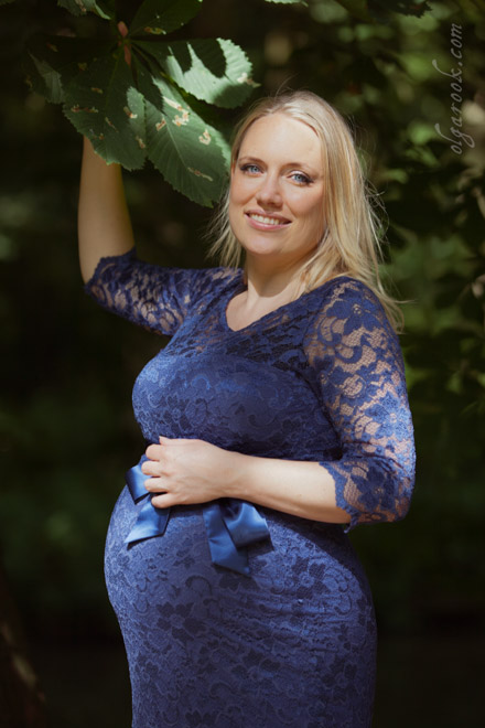 Colour portrait of a beautiful pregnant woman in a park.