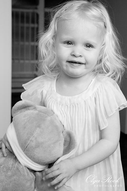 Photo of a two-year old girl holding her Teddy bear