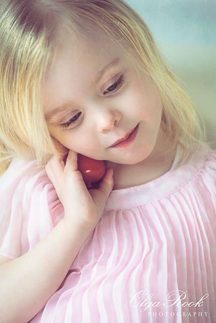 Dreamy portrait of a little girl wearing a pink dress