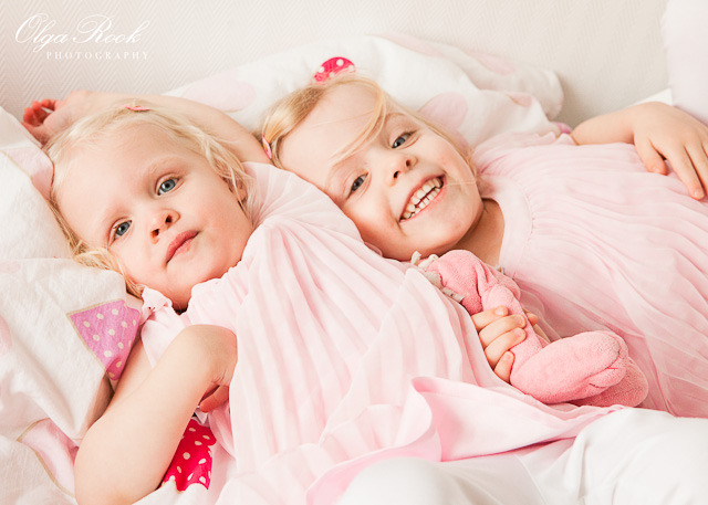 Portrait of two little sisters playing