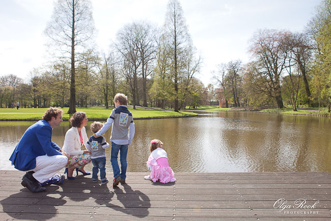 Family with children walking in the Euromast park in Rotterdam on a sunny spring morning.