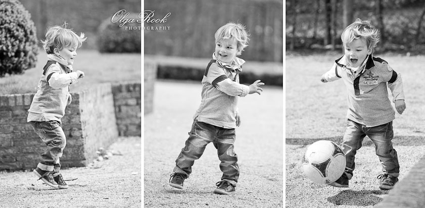 Laughing little boy springs, dances and plays football in a park.