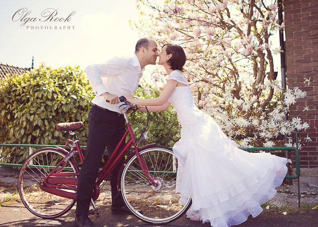 Romantic portrait of a bride and a groom with a bicycle.