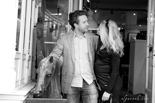 Black and white photo of a couple at an antique shop.