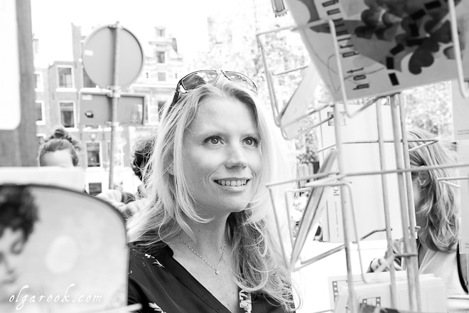 Photo of a blond girl looking at vintage postcards in a small boutique in Amsterdam.