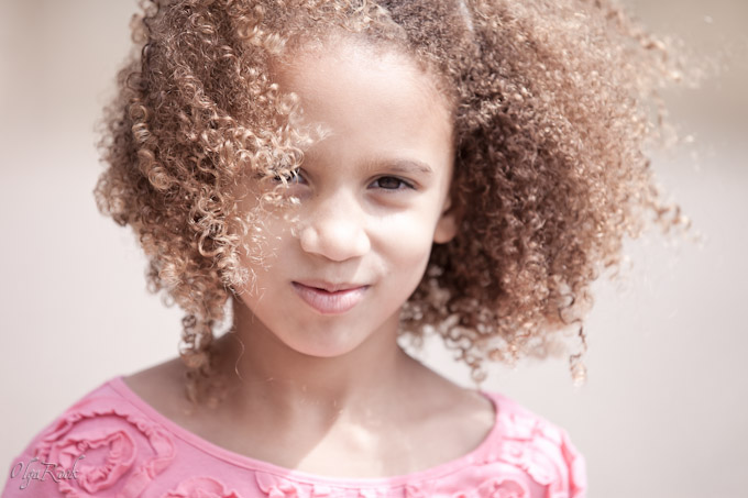 romantic portrait of a curly little girl