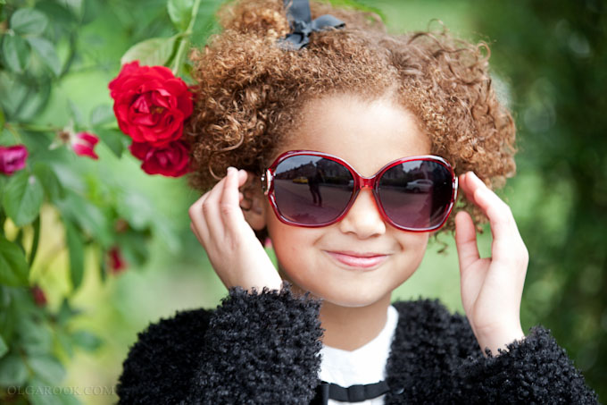 colourful portrait of a little girl wearing sun glasses