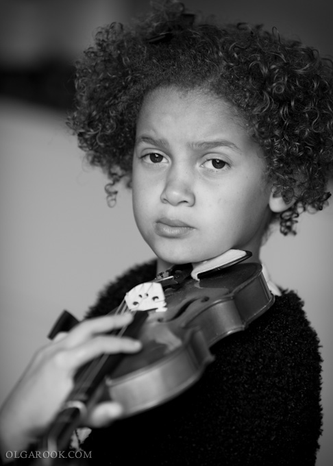 a little musician: portrait of a little girl with a violin