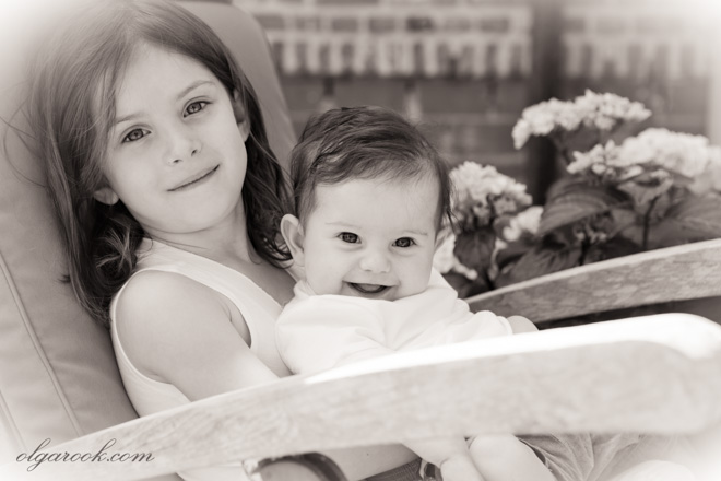 Portrait of two little sisters. The photo has a vintage effect.