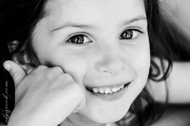 Black and white photo of a little girl laughing.
