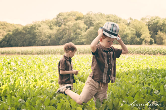Photo of two little boys playing in a field.