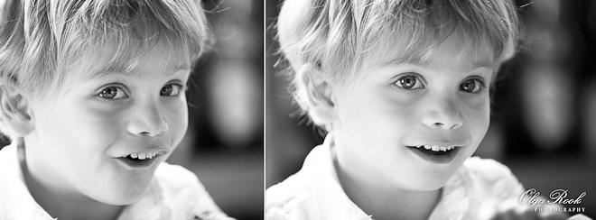 Portret van een klein blond jongentje, die graapig en ondeugend kijkt.