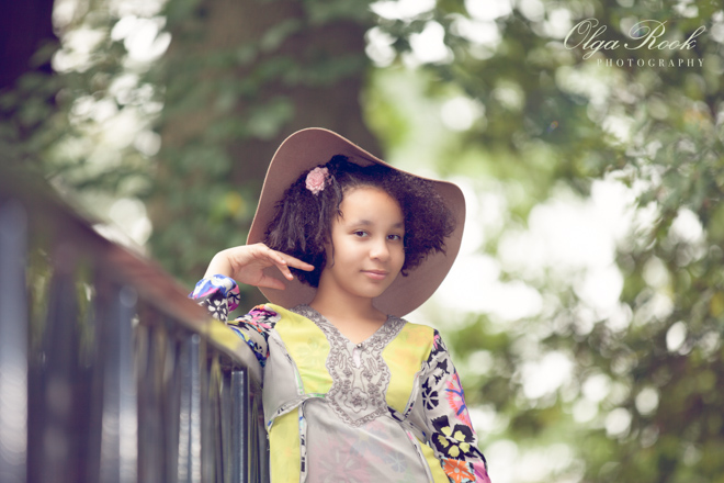 Painterly child portrait: a girl wearing a hat.