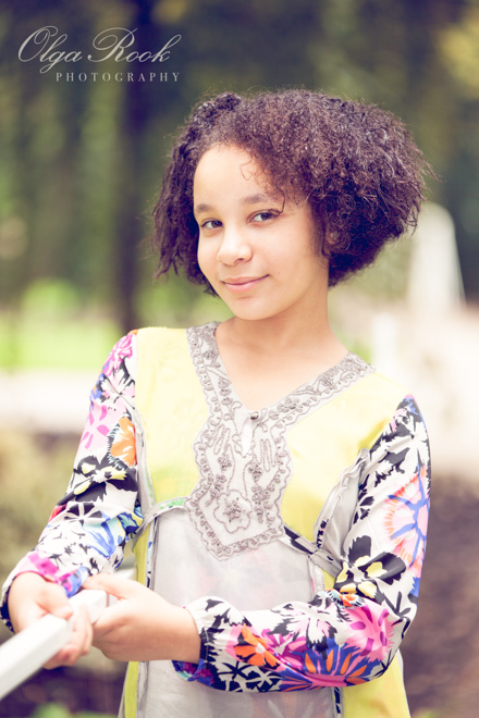 Child portraiture: color photo of a curly girl