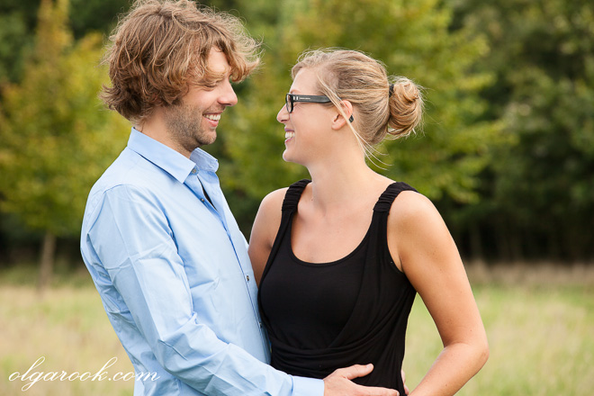 Photo of a lauging couple in a park