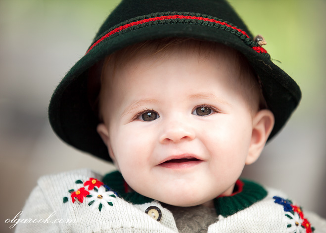 Color portrait of a baby boy wearing a Tirolean hat