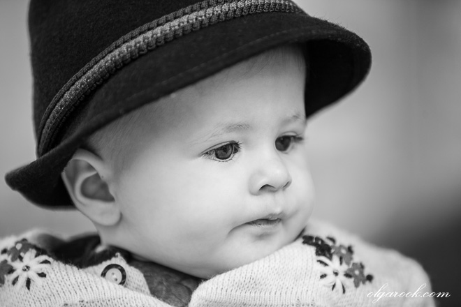 Black and white portrait of a little boy wearing a Tirolean hat