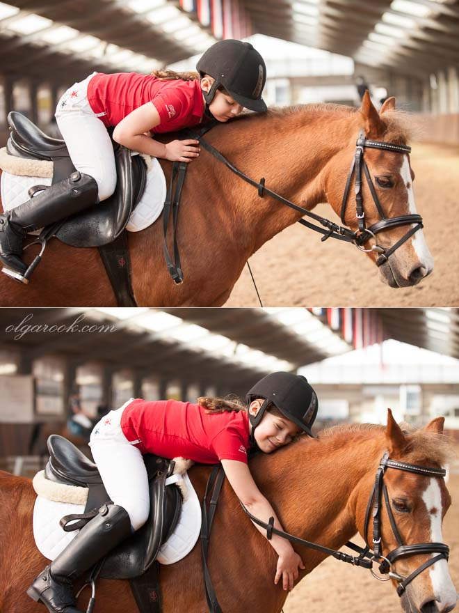 Emotional portraits of a little jockey-girl on a horseback