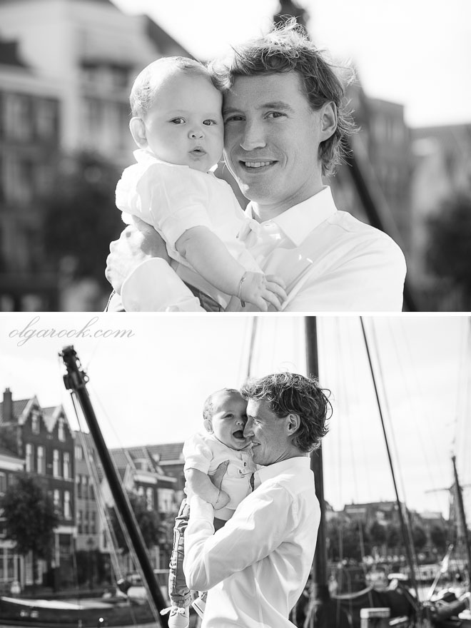 Classic black and white photos of a father and his baby son in a small harbour in Rotterdam