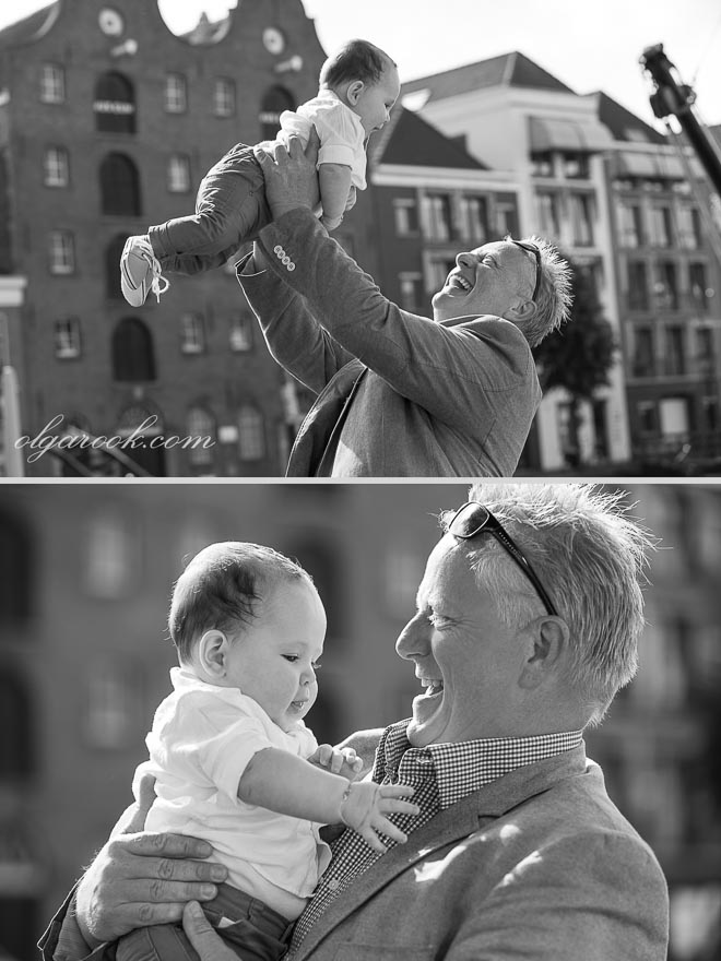 Black and white portraits of a baby and his grandfather who is proud and happy with the little boy