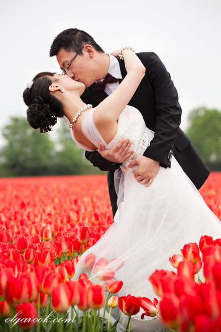 Portrait of a romantic couple in a flower field