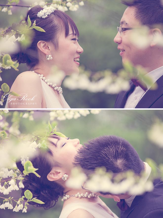 Romantic photos of a couple laughing and kissing among the blossoms