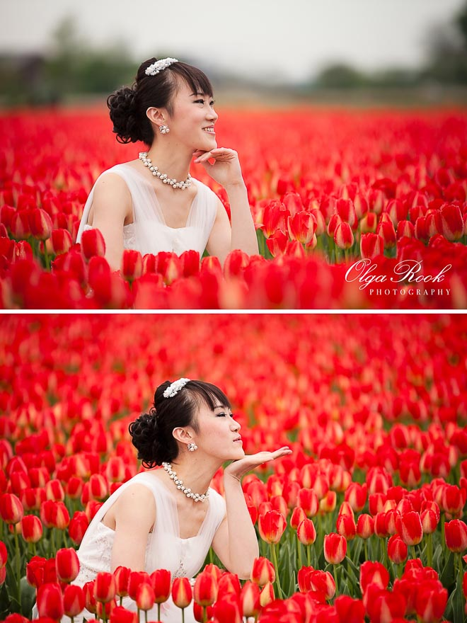 portrait of Chinese bride posing in a flower field among the red tulips