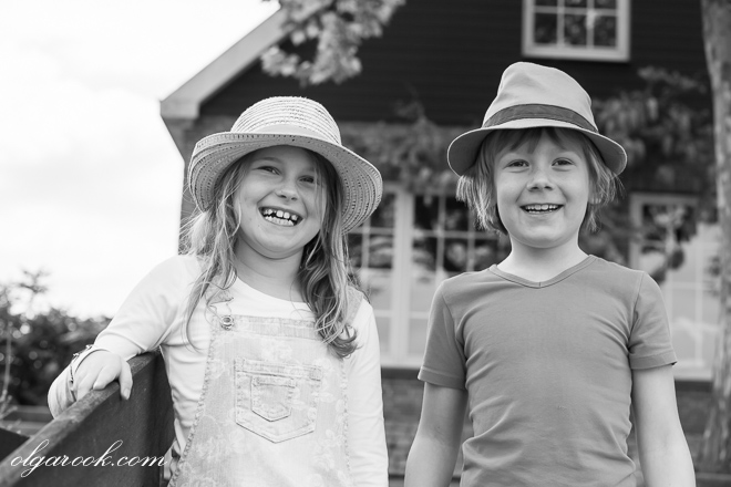 Photo of laughing children wearing hats