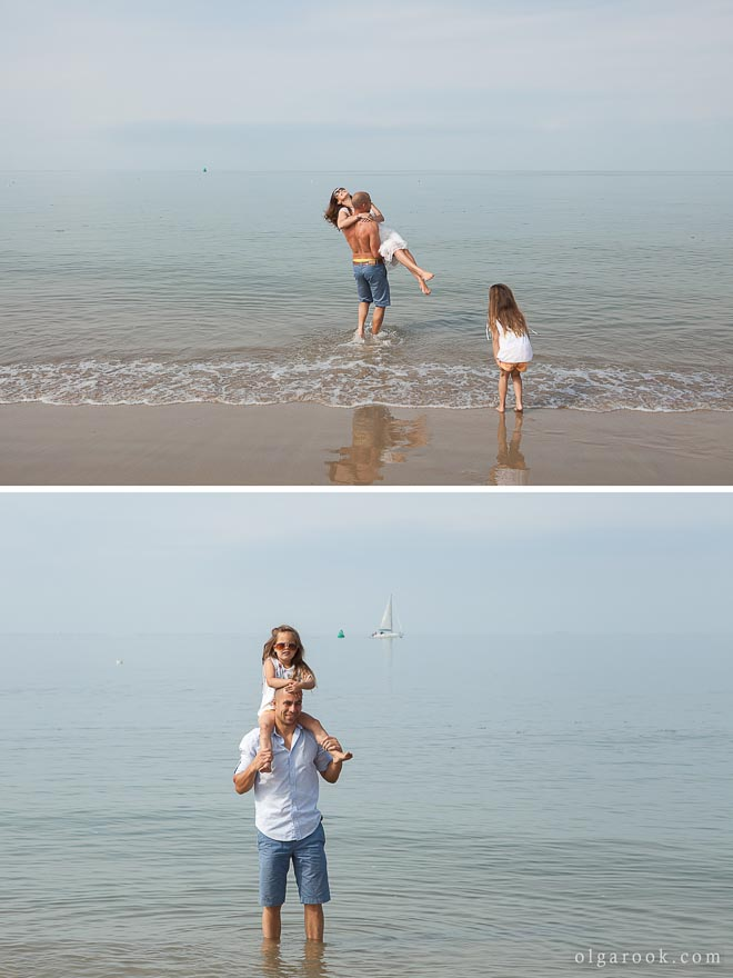 Photo of parents and their little daughter at the sea.