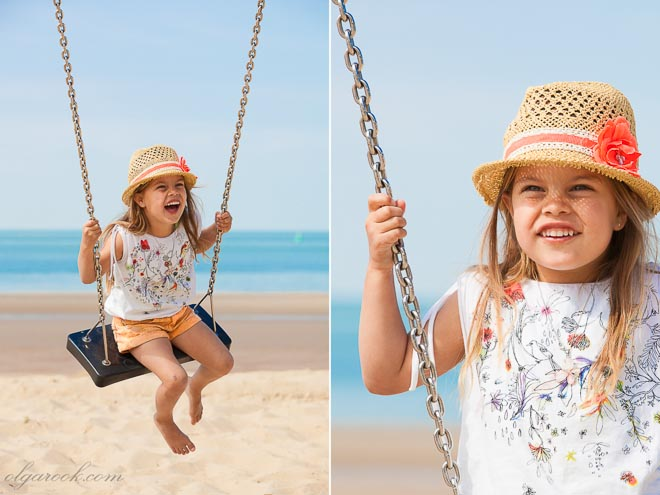 Photos of a little girl on a swing at the beach