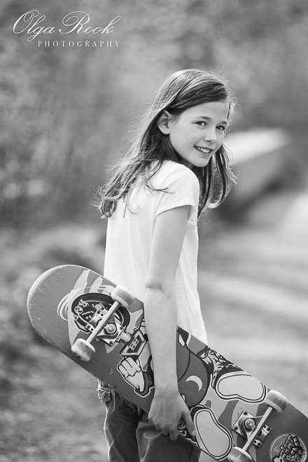 Portrait of a school girl with a skateboard