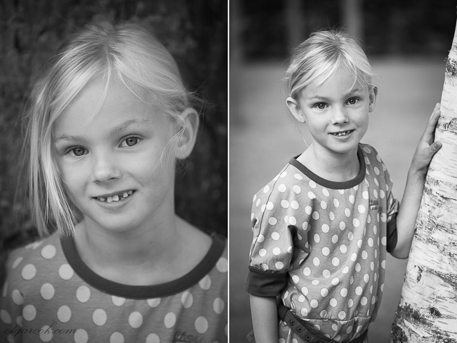 Black and white outdoor portrait of a blond little girl