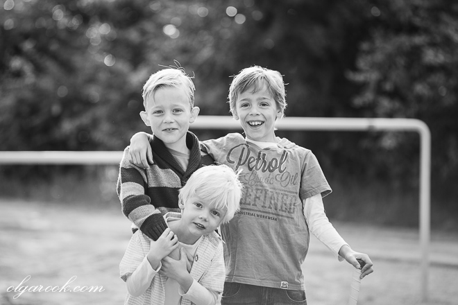 Portrait of three little brothers together on a playground