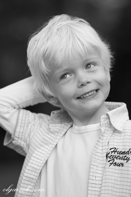 Natural portrait of a small blond boy with an impish expression