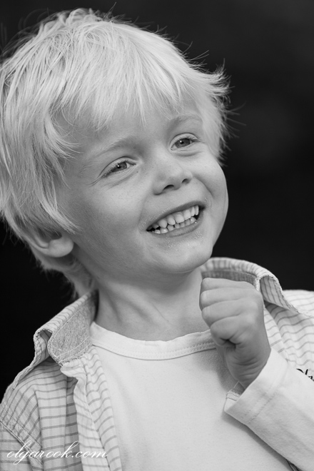 Black and white portrait of a laughing little boy