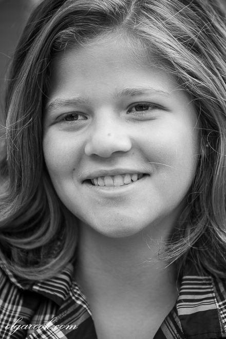 black and white portrait of a girl with a friendly smile