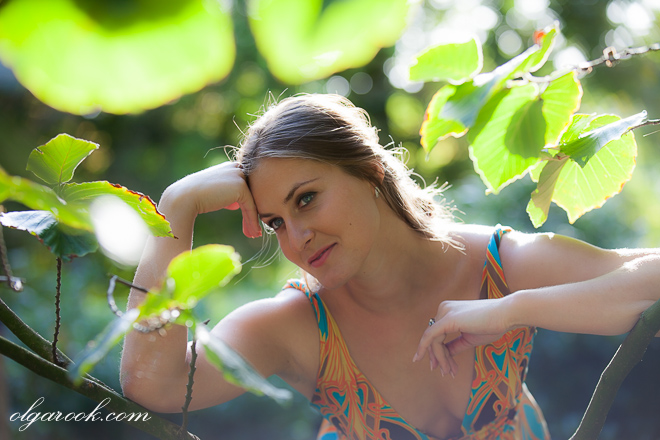 Dreamy and colourful portrait of a young woman in a garden