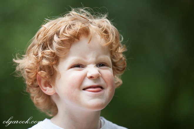 photo of a redhead little boy making funny faces