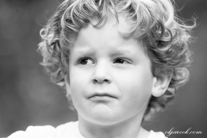 black and white portrait of a little boy with a bossy expression on his face