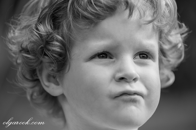 Retro-like black and white portrait of a curly child