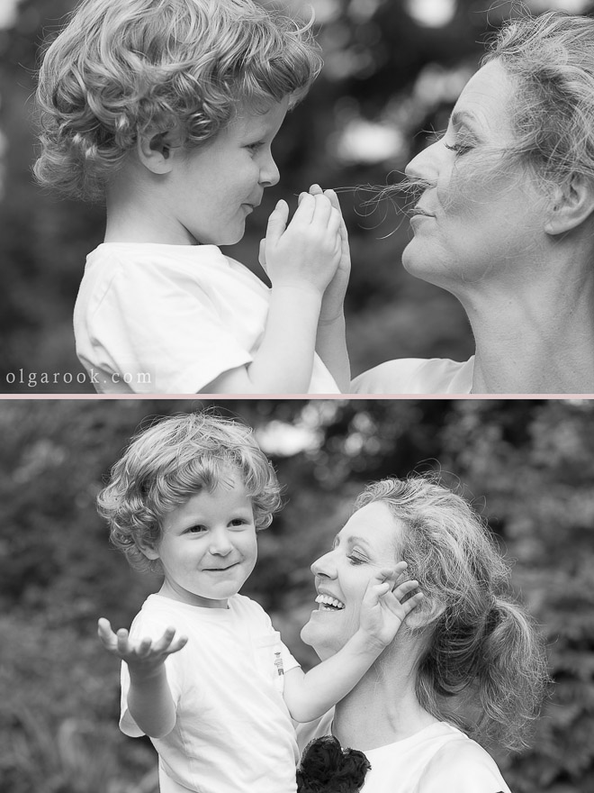 Black and white portraits of a little boy playing with his mother