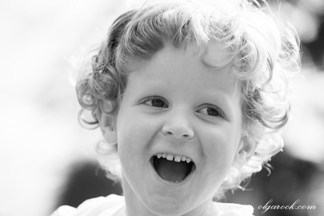 black and white photo of a laughing child