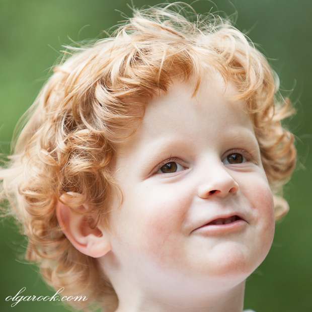 photo of a funny curly little boy