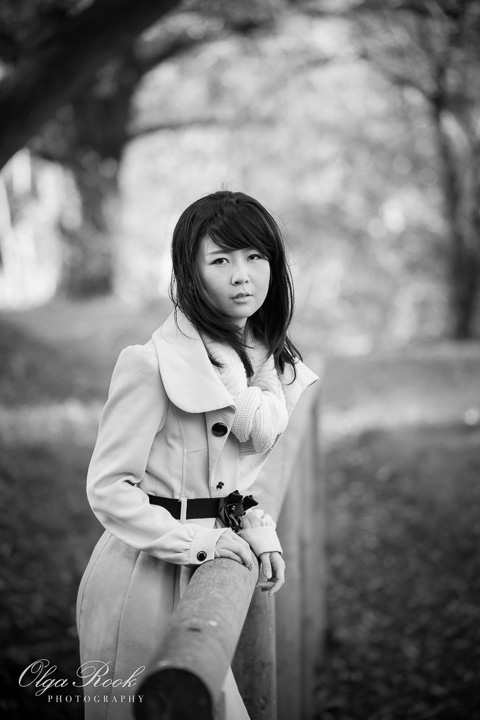Nostalgic black and white portrait of an Asian girl in an autumn park